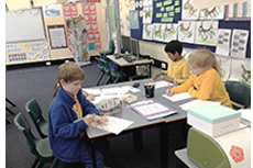 Younger students focus on their writing during our Literacy Festival 2014