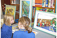Some younger students deep in discussion about original illustrator artwork – Literacy Festival 2014