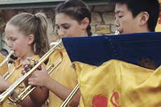 Students in our Year 6 brass band perform at Downer Preschool's 50th birthday celebrations