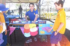 A Year 6 student showcases her stall for Mini Market Day